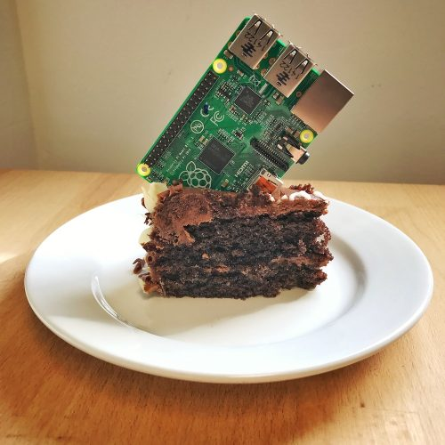A Raspberry Pi stuck into a piece of birthday cake