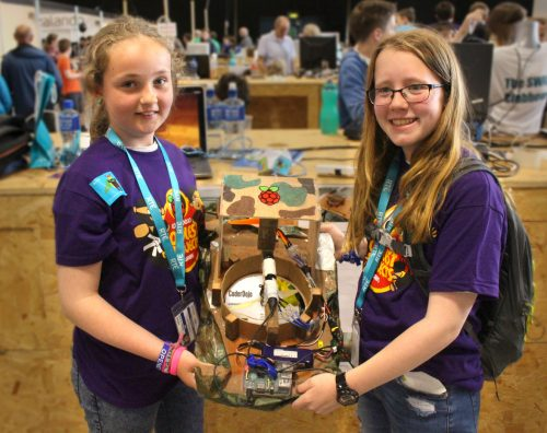 At a Coolest Projects event, wo girls show off the digital making projects they've coded.
