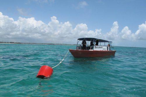 boat anchored at buoy