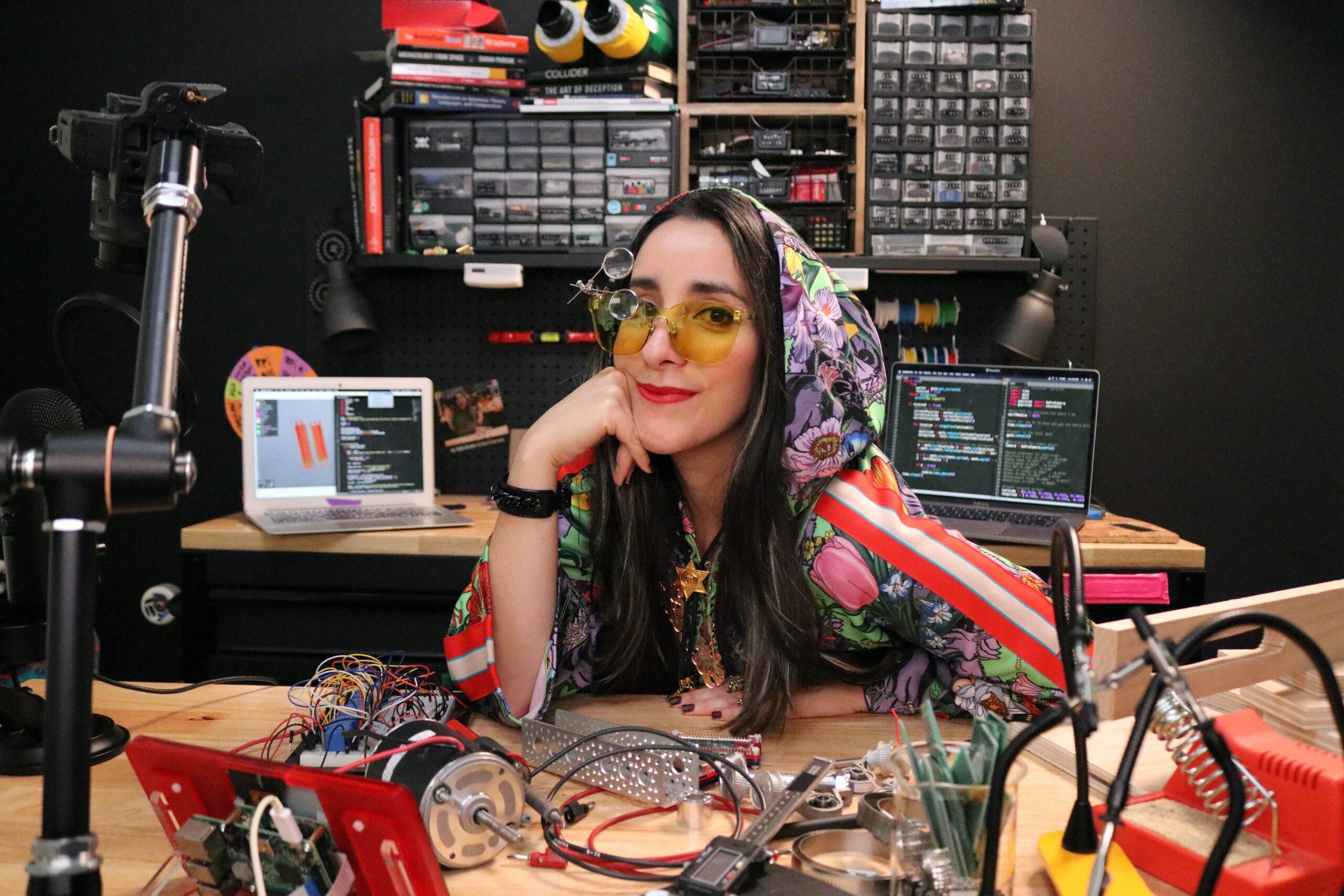 estefannie at her desk in colourful hoodie