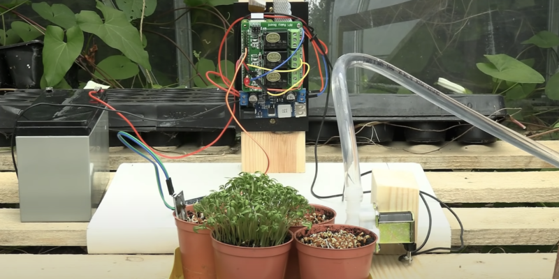 plant watering system full set up in maker's greenhouse